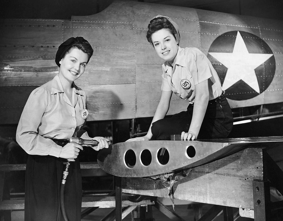 Adult Photograph - Two Women Working On Airplane by George Marks