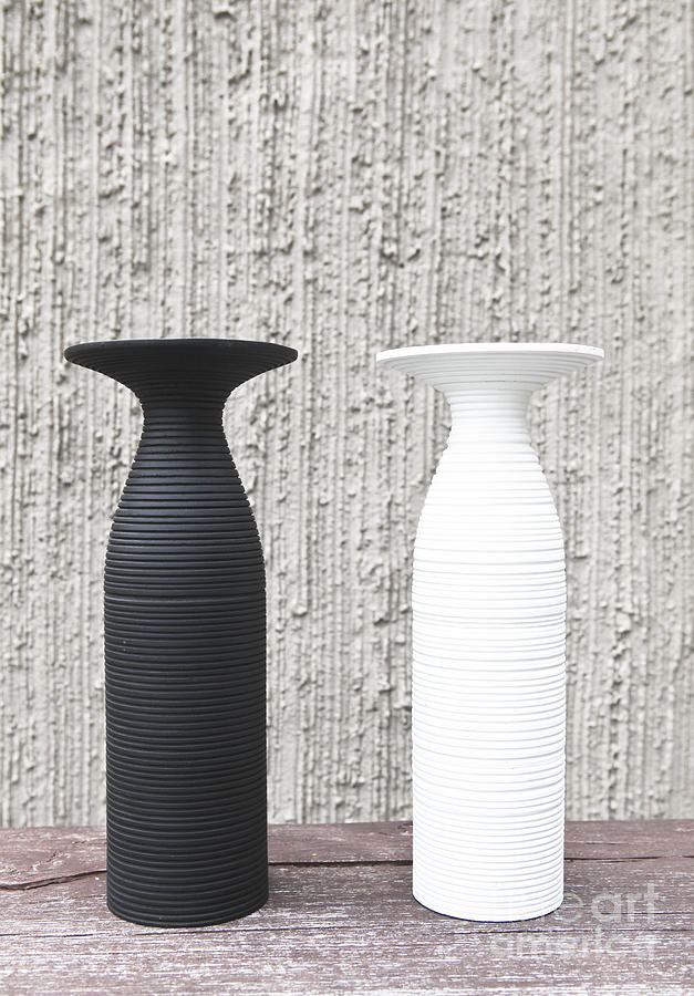 Background Photograph - twoWhite and black vases by Chavalit Kamolthamanon
