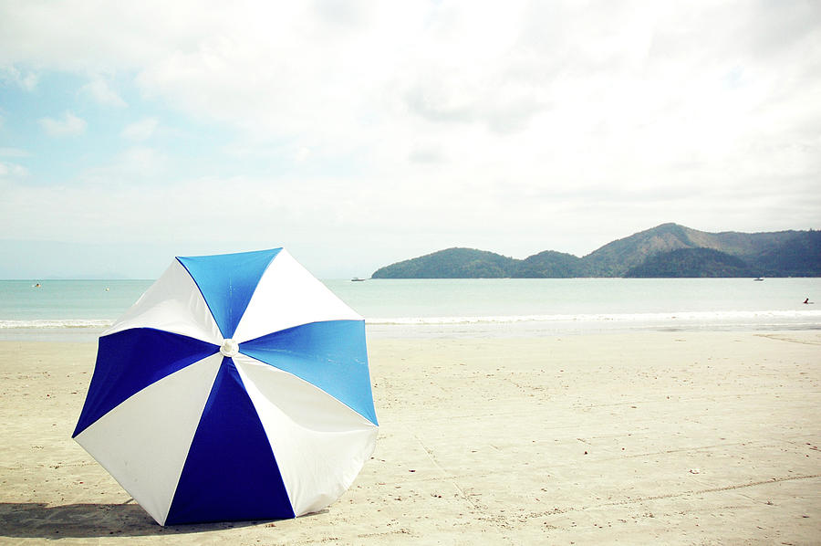 Horizontal Photograph - Umbrella On Sand by Grace Oda