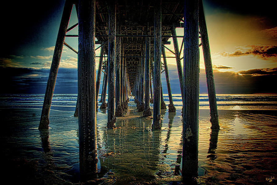 Sunset Photograph - Under The Boardwalk by Chris Lord