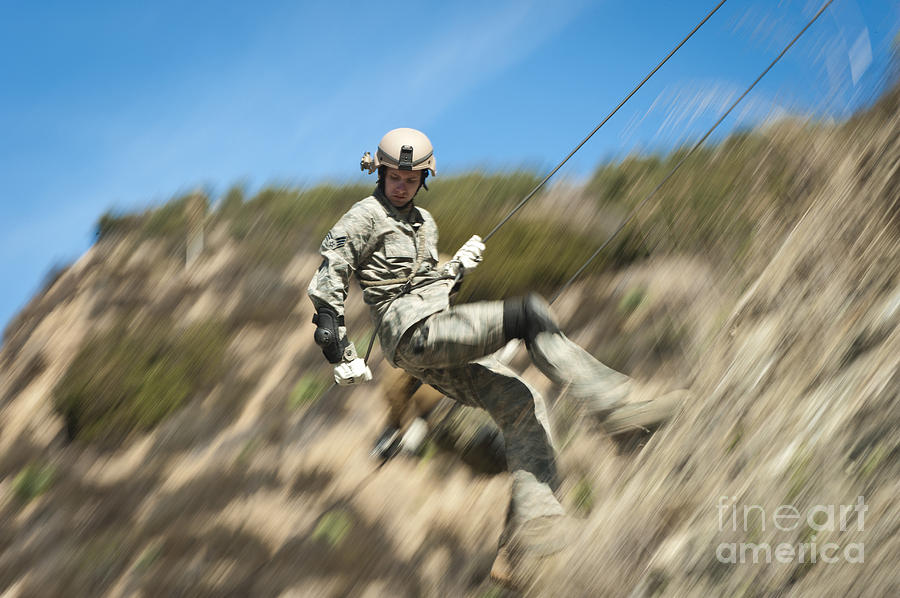 Military Photograph - U.s. Air Force Airman Practices by Stocktrek Images