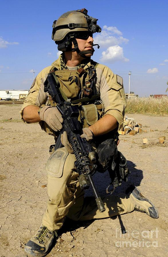 U.s. Air Force Pararescueman Conducts Photograph