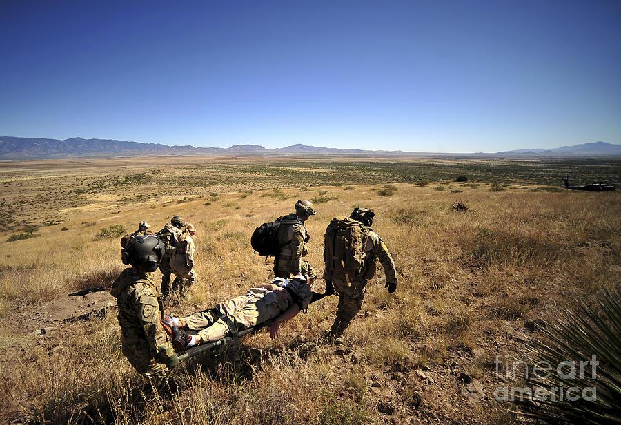 Men Photograph - U.s. Air Force Pararescuemen Carry by Stocktrek Images