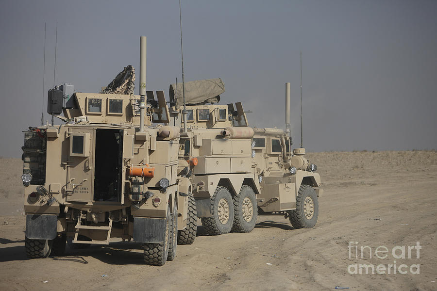 Kunduz Photograph - U.s. Army Cougar Mrap Vehicles by Terry Moore