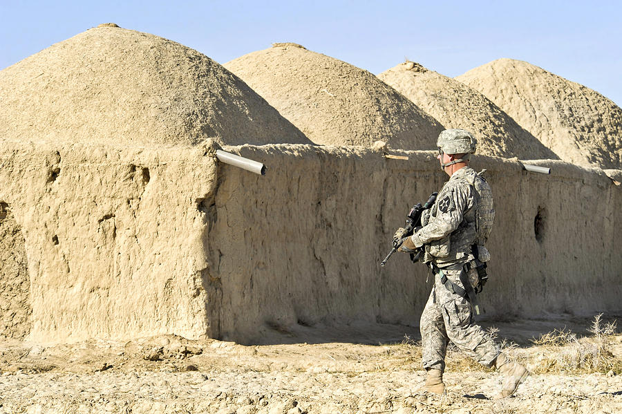 Village Photograph - U.s. Army Soldier Conducts A Dismounted by Stocktrek Images