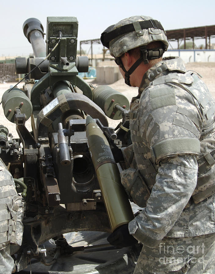 Army Photograph - U.s. Army Soldier Loads A 105mm by Stocktrek Images