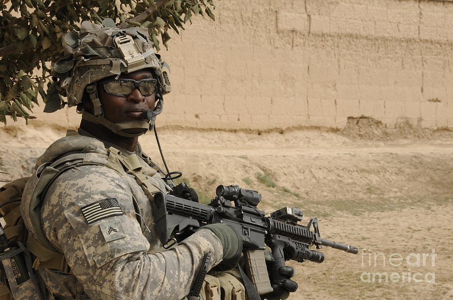 Afghanistan Photograph - U.s. Army Soldier Scans His Area While by Stocktrek Images