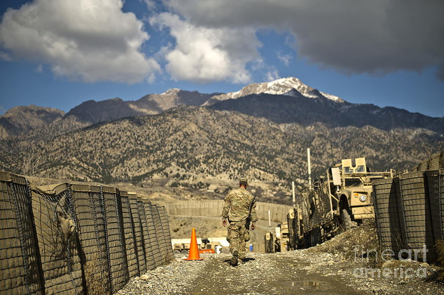 Military Photograph - U.s. Army Soldier Walks Down A Path by Stocktrek Images