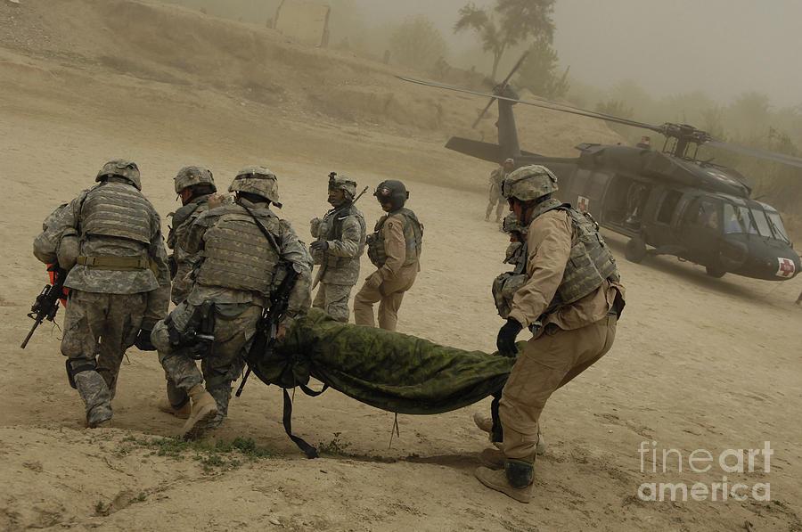 Medium Group Of People Photograph - U.s. Army Soldiers Medically Evacuate by Stocktrek Images