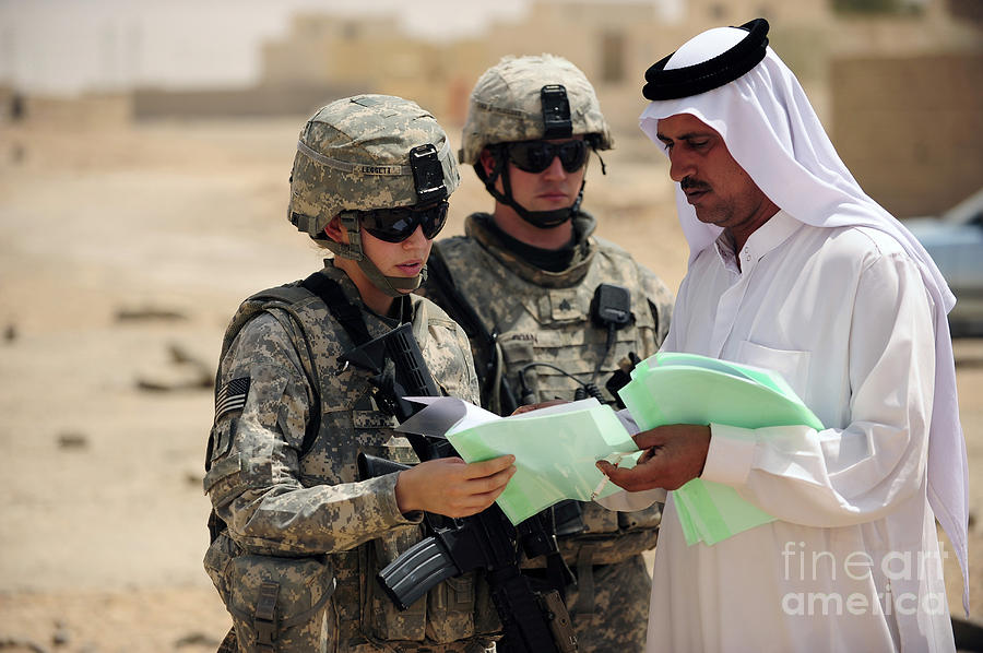Operation Iraqi Freedom Photograph - U.s. Army Soldiers Talking With A Town by Stocktrek Images