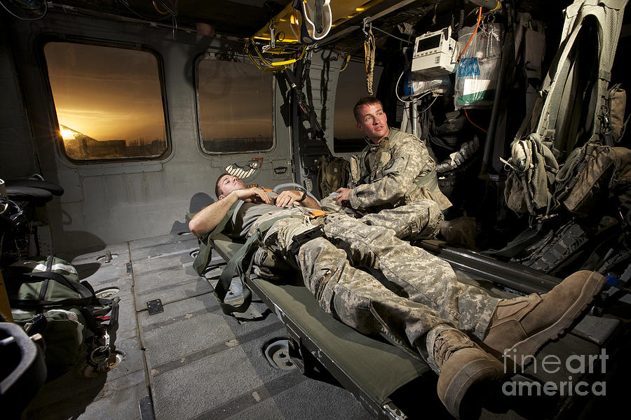 Us Army Photograph - U.s. Army Specialist Practices Giving by Terry Moore