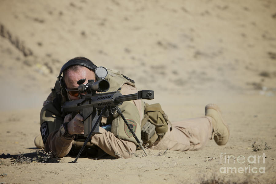 Isaf Photograph - U.s. Contractor Sights In A Barrett by Terry Moore