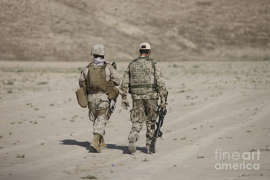 Kunduz Photograph - U.s. Marine And German Soldier Walk by Terry Moore