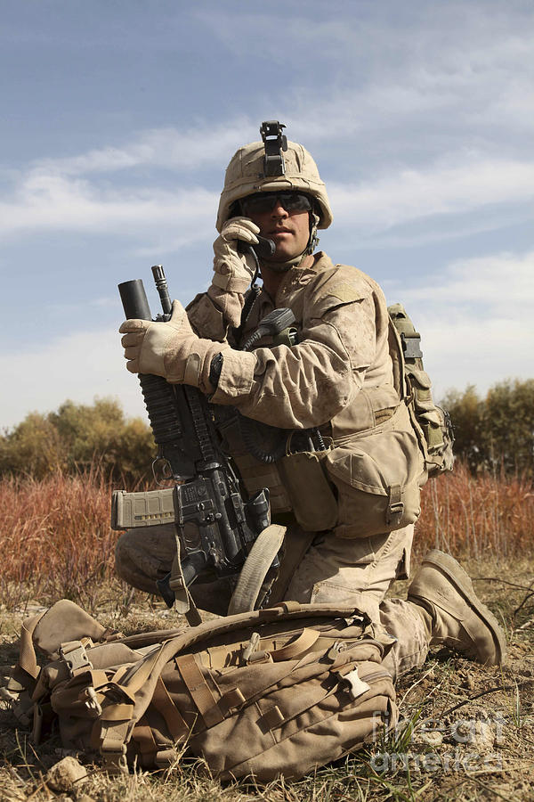Soldier Photograph - U.s. Marine Communicates by Stocktrek Images
