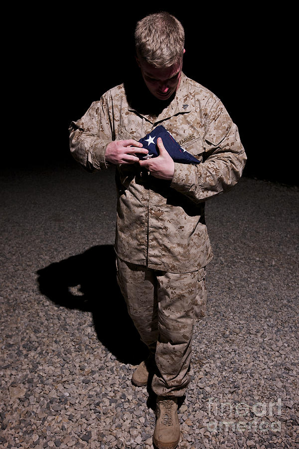 Us Flag Photograph - U.s. Marine Holding The American Flag by Terry Moore