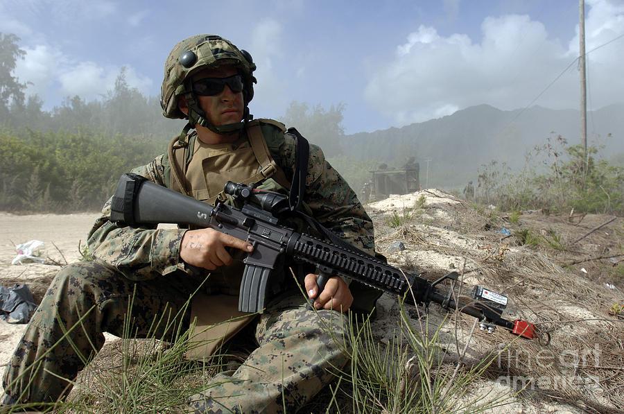 Assault Photograph - U.s. Marine Takes Part In An Amphibious by Stocktrek Images