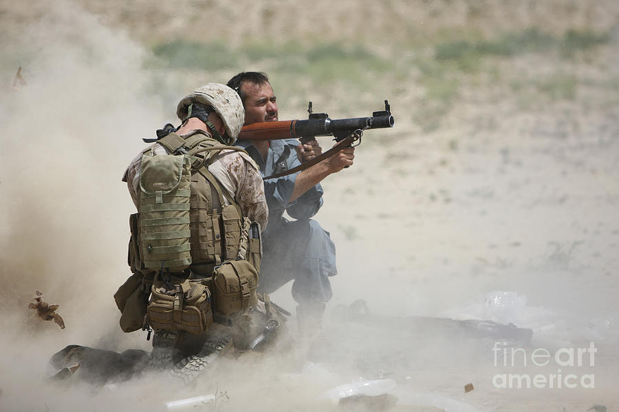 Afghanistan Photograph - U.s. Marine Watches An Afghan Police by Terry Moore