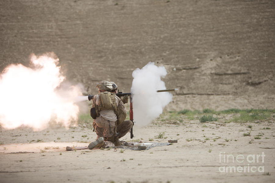 Desert Photograph - U.s. Marines Fire A Rpg-7 Grenade by Terry Moore