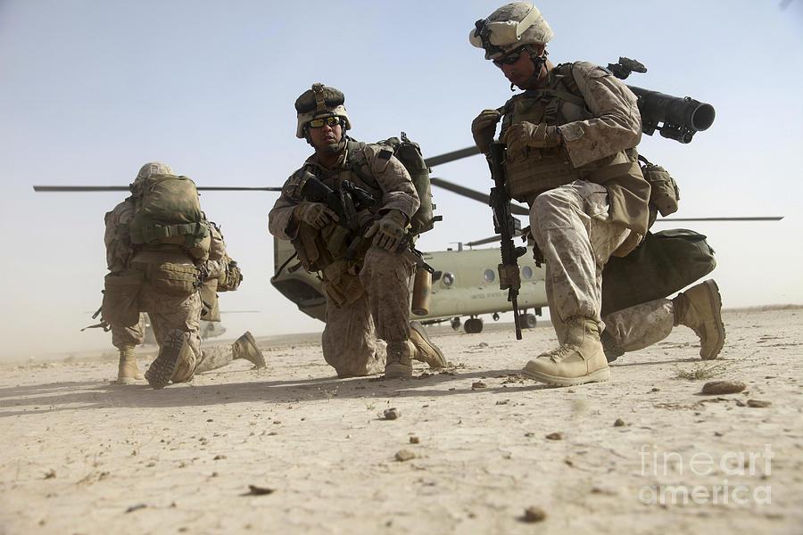 Marines Photograph - U.s. Marines Unloading by Stocktrek Images