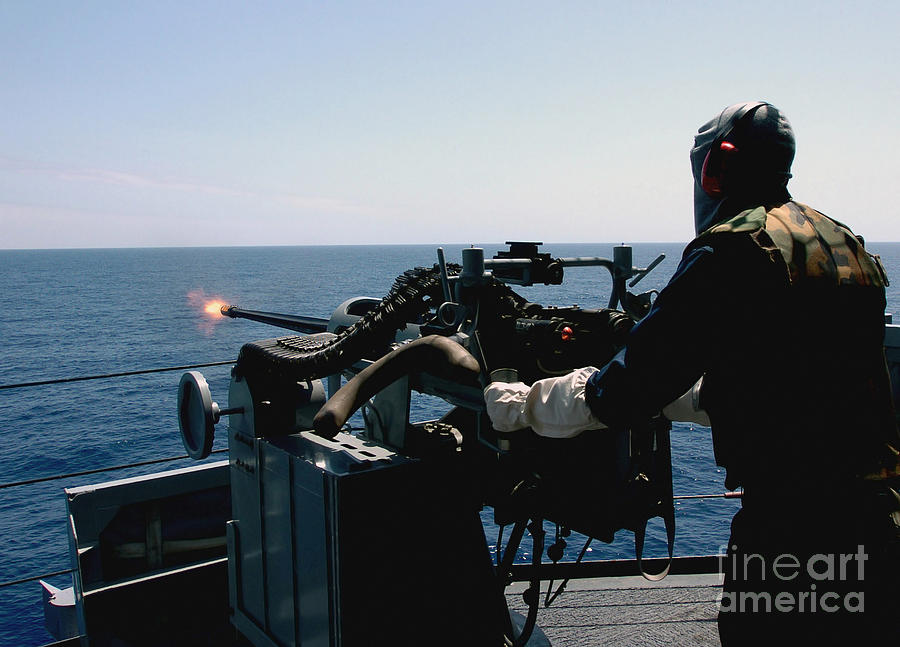 U.s. Navy Gunners Mate Fires A Mark 38 Photograph by Stocktrek Images