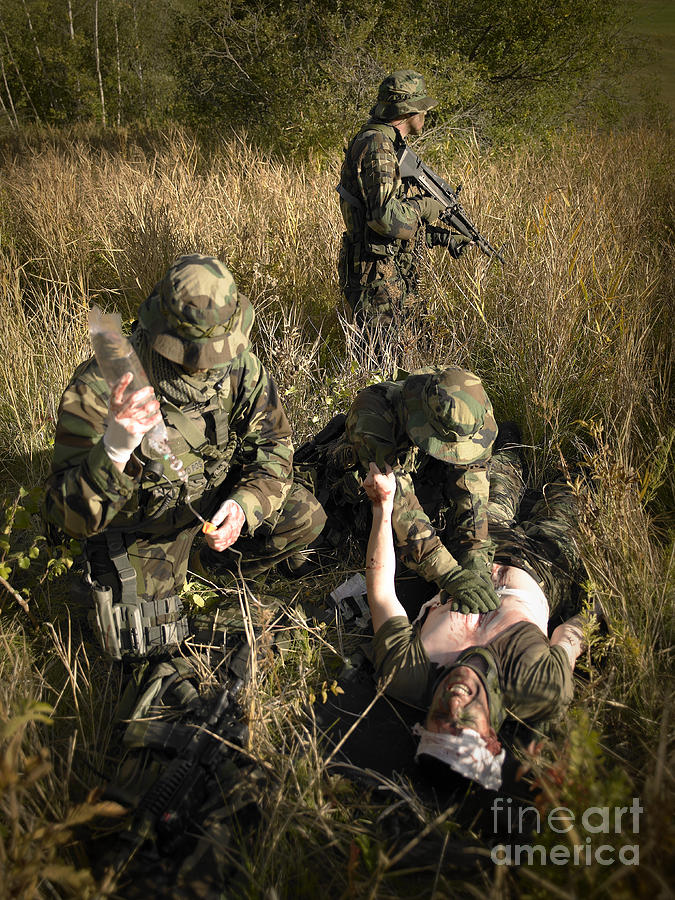 Special Operations Forces Photograph - U.s. Navy Seals Give First Aid by Tom Weber