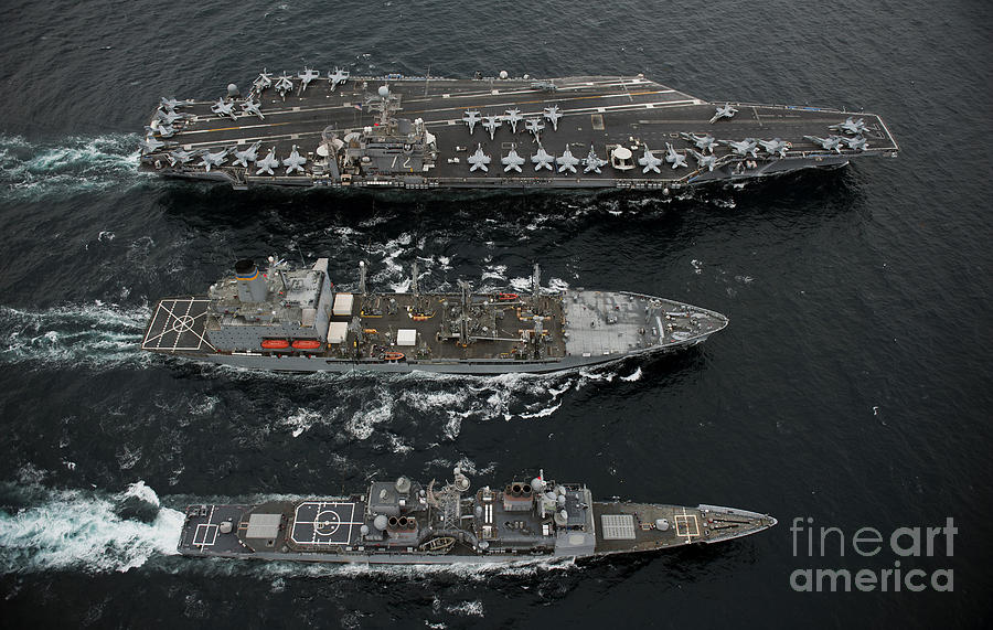 Us Navy Photograph - U.s. Navy Ships Conduct A Replenishment by Stocktrek Images
