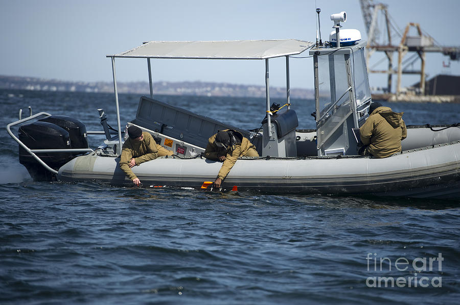 Canada Photograph - U.s. Sailors Deploy An Unmanned by Stocktrek Images
