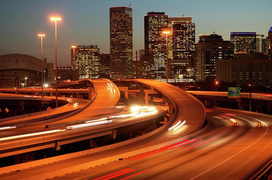 Horizontal Photograph - Usa, Texas, Houston City Skyline And Motorway, Dusk (long Exposure) by George Doyle