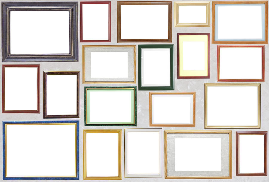 Various wooden photo frames hang on a wall photograph by for Hanging frames on walls