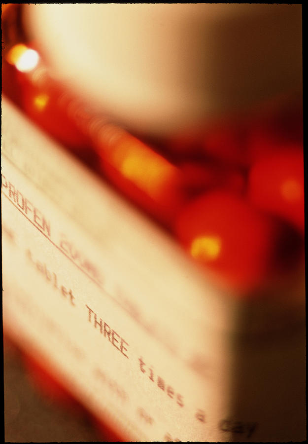 Pain Killer Photograph - View Of A Bottle Of Ibuprofen Pills by Jeremy Walker