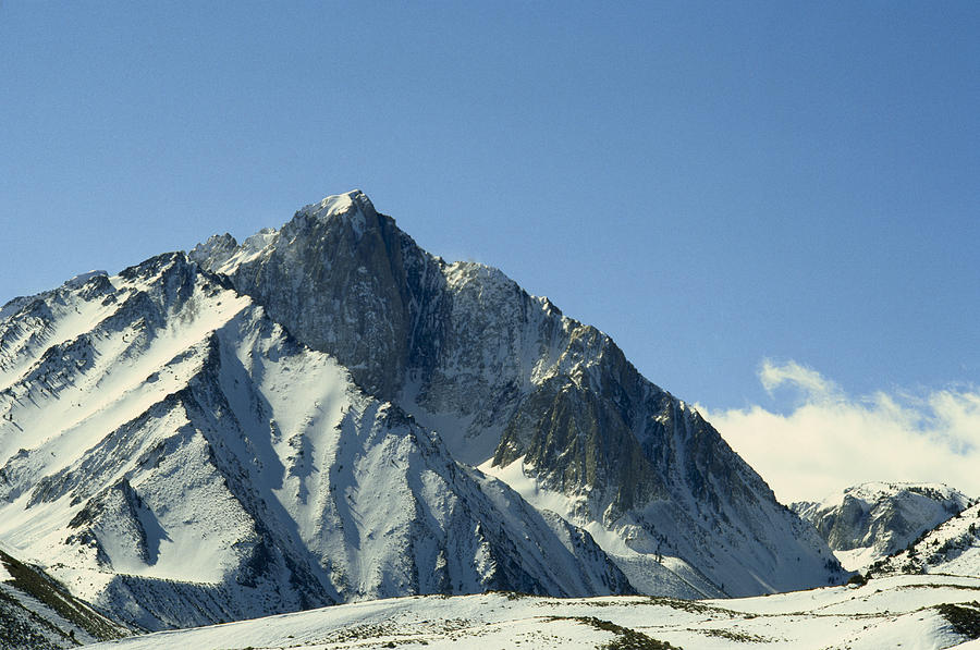 Color Image Photograph - View Of Snow-covered Mountain Ridges by Gordon Wiltsie