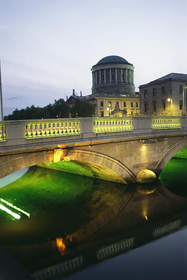 Structures Photograph - View Of The Four Courts And The Liffey by Richard Nowitz