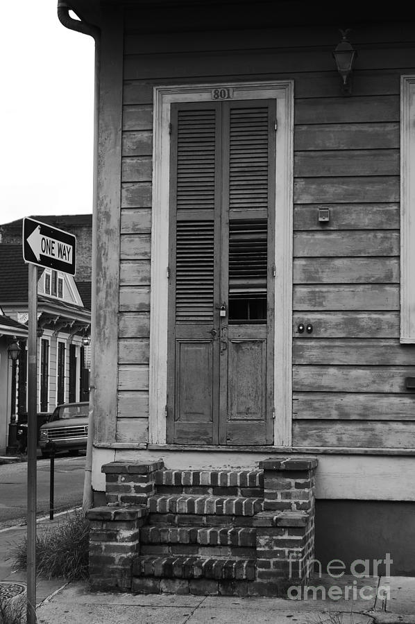 Big easy photograph vintage aged wooden door and brick stoop french quarter new orleans black