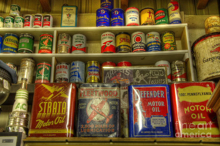 Vintage Garage Oil Cans Photograph By Bob Christopher