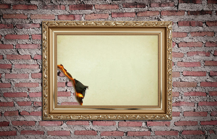 vintage gold frame with burned on wall background photograph by