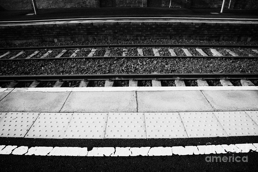 Railway Photograph - Warning Line And Textured Contoured Tiles Railway Station Platform And Track Northern Ireland by Joe Fox