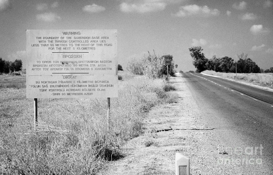 Sba Photograph - warning road sign warning of the border of the turkish military controlled area of the SBA Sovereign by Joe Fox
