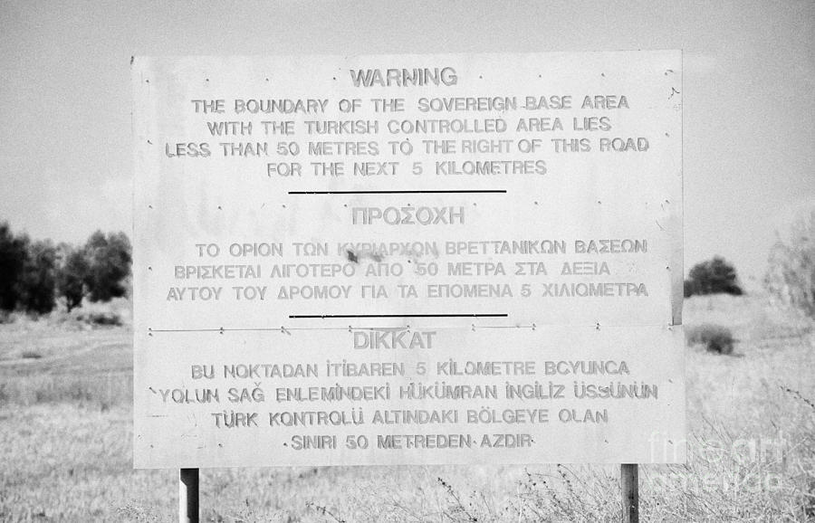 Sba Photograph - warning sign warning of the border of the turkish military controlled area of the SBA Sovereign Base by Joe Fox
