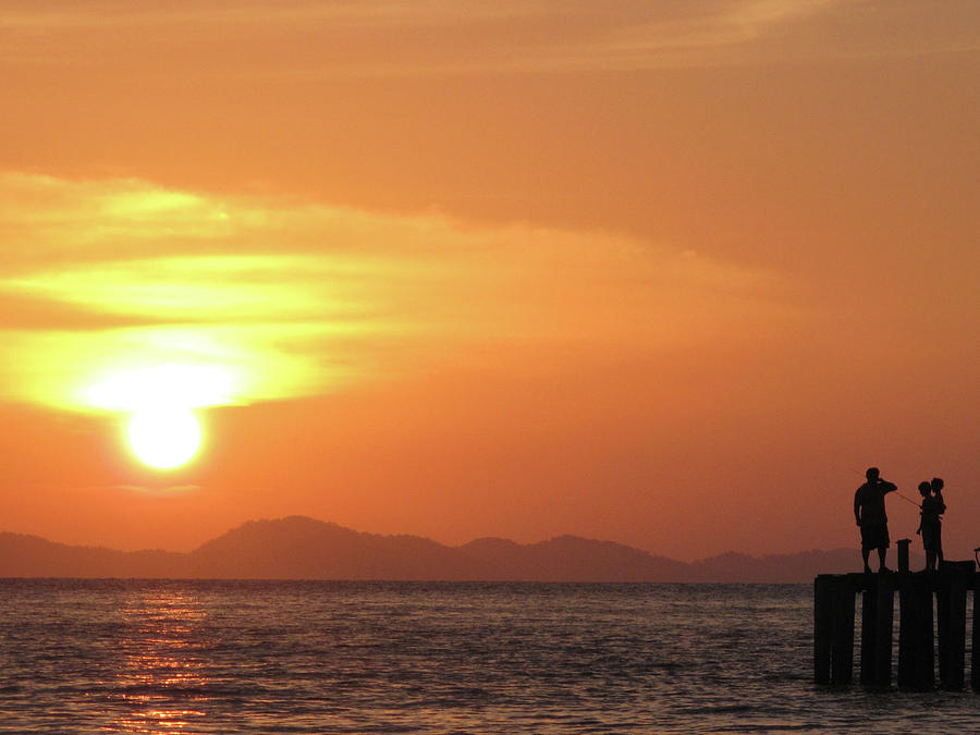 Horizontal Photograph - Watching A Sunset From The Jetty by Thepurpledoor