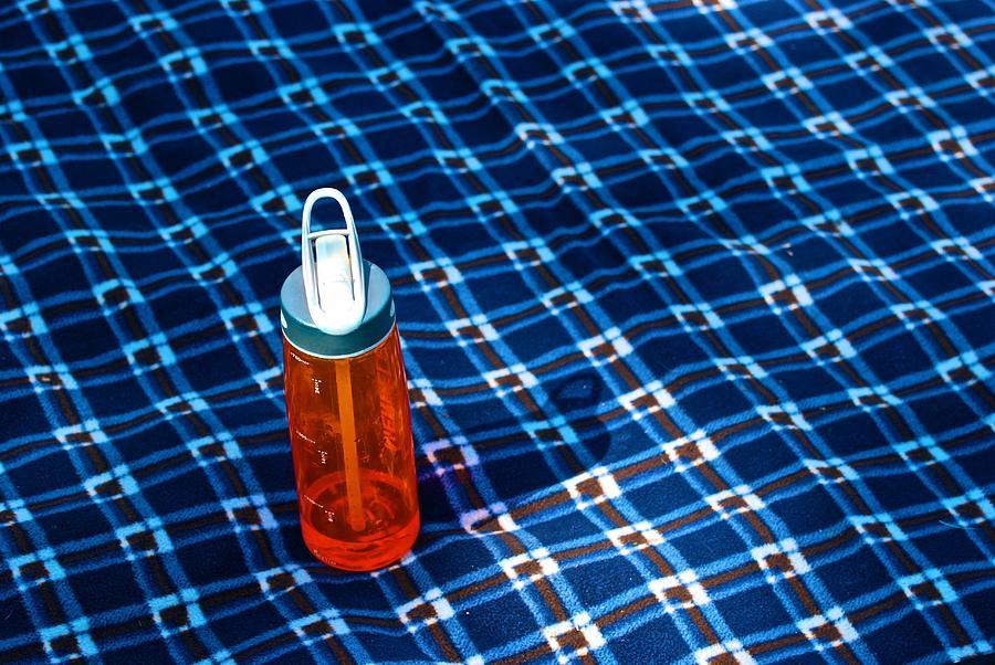 Water Bottle Photograph - Water Bottle On A Blanket by Eric Tressler