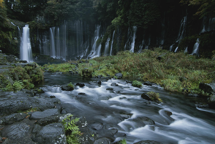 Asia Photograph - Water Falling And Flowing Over Rocks by Karen Kasmauski