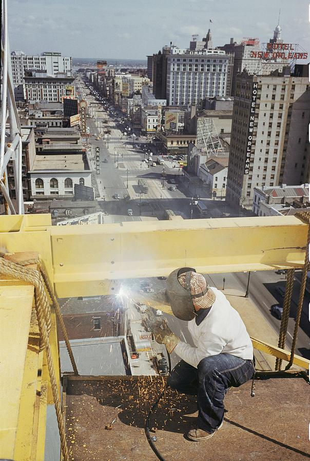 Canal Street Photograph - Welder Working On The Construction by Justin Locke