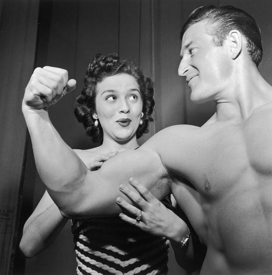 Adults Only Photograph - What Muscles! by Archive Photos