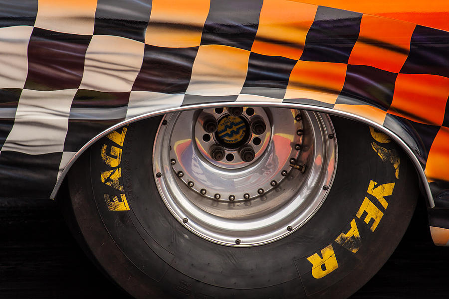 Close Photograph - Wheel And Chequered Flag by Ken Brannen