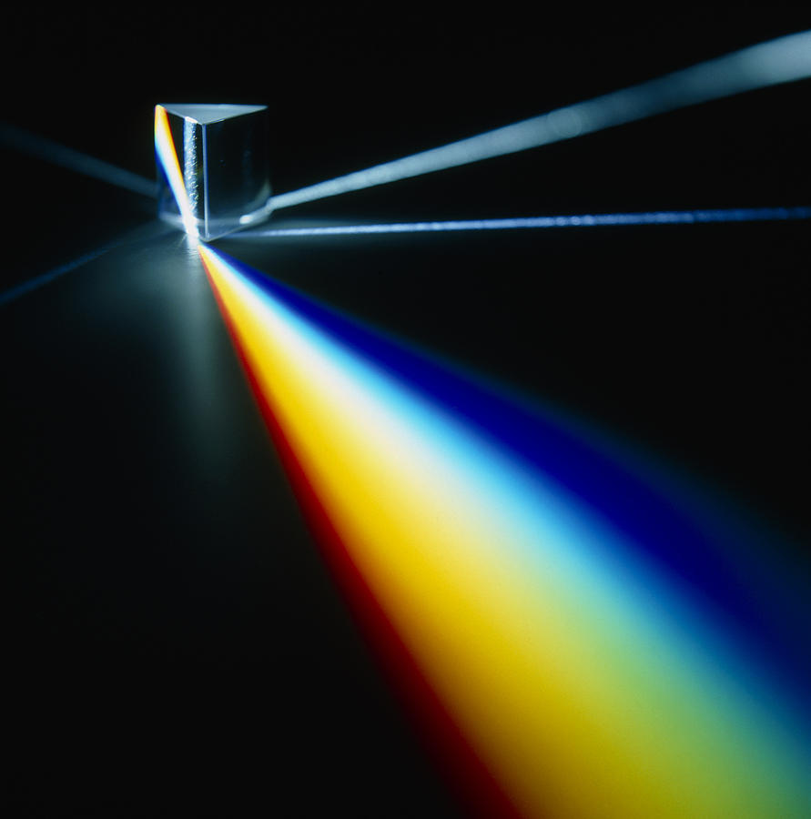 white light split into colours by a prism photograph by pasieka