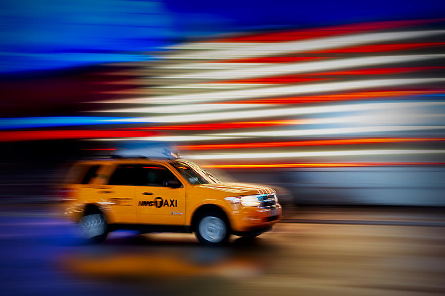 New York City Taxi Photograph - Whizzing Along by Susan Candelario