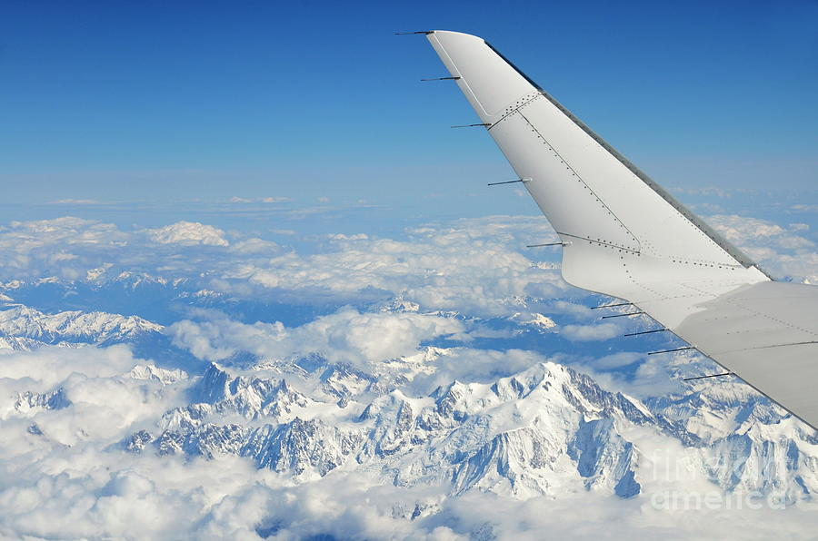 Freedom Photograph - Wings Of Flying Airplane Over French Alps by Sami Sarkis
