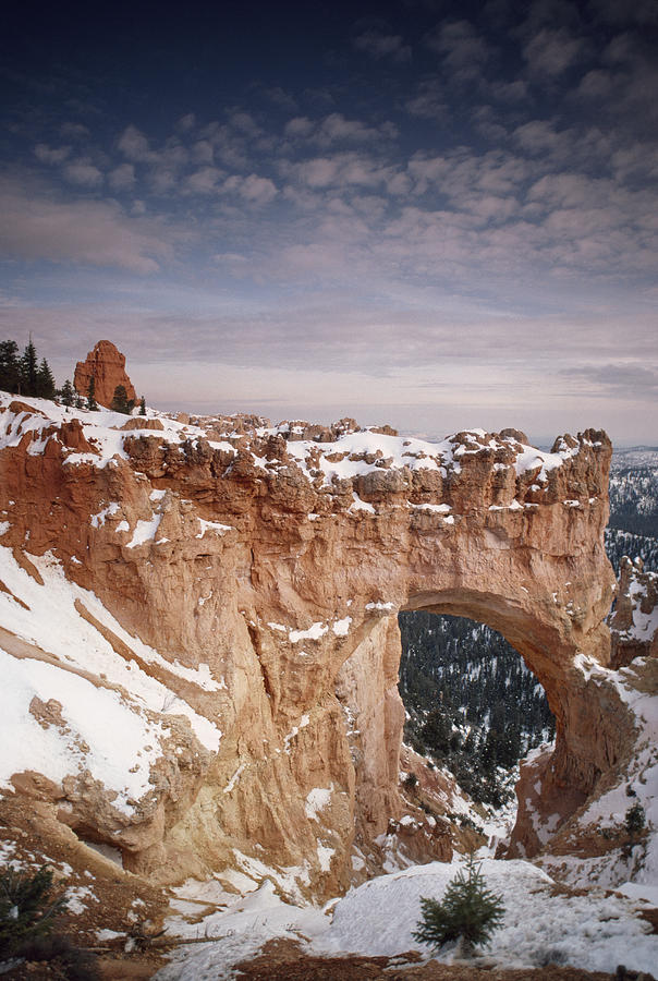Color Image Photograph - Winter Snow Covers The Eroded Natural by Gordon Wiltsie