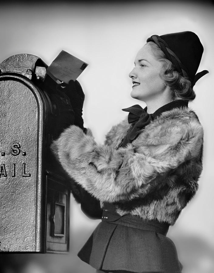 Adult Photograph - Woman Dropping Letter Into Mailbox by George Marks