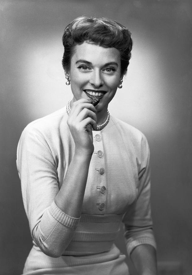 Adult Photograph - Woman Eating Chocolate In Studio, (b&w), Portrait by George Marks